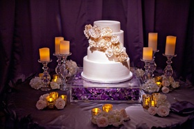 Four layer cake with fresh gold-painted peonies