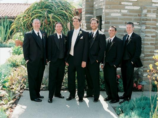 Groom and groomsmen in suits at La Jolla wedding