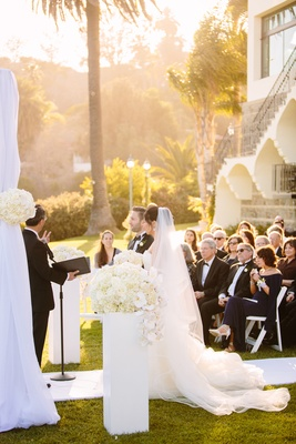 interfaith ceremony, veil, white chuppah  bel air bay club wedding ceremony white flowers