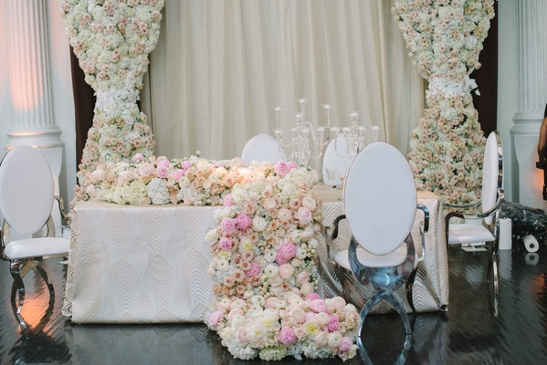 revelry event designers chrome white modern chairs contrast with soft floral runner pink ivory