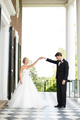 Bride and groom first look on checkered patio floor