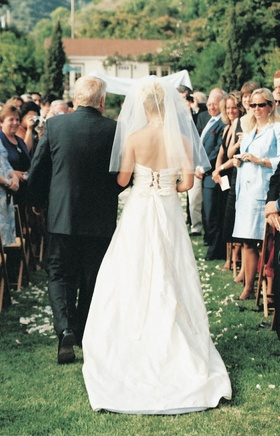Bridal gown with laced up back and bow