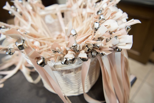 wedding ceremony favors for guests pink ribbon silver bells for guests to wave after ceremony