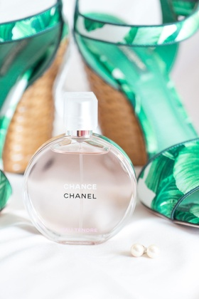 Chance by Chanel perfume with wedding shoes palm tree print and pearl earrings studs