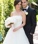 Bride in strapless a-line wedding dress Monique Lhuillier white bouquet black tuxedo bow tie