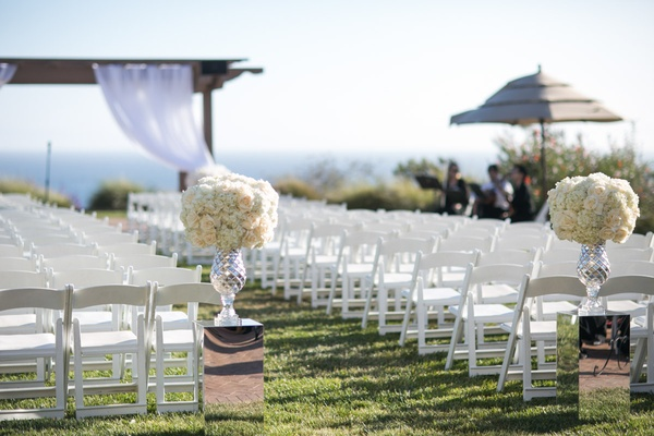open air ceremony space reflective stands florals beach ocean cliffside gazebo glass