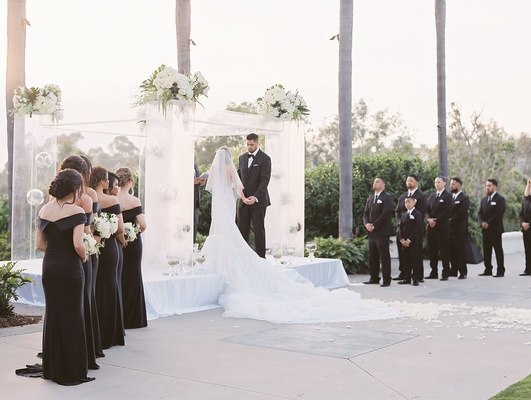 Levine Toilolo and Stephanie Ming stage wedding ceremony outdoor bridesmaids in black dresses