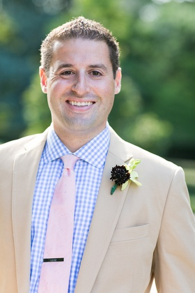 Tan suit with casual gingham shirt and pink tie