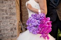 Flower handbag on arm instead of bouquet purple orchid fuchsia pink phalaenopsis orchids