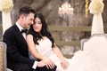 bride in vera wang, groom in armani collezioni, newlyweds sit together after ceremony