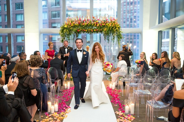 Wedding ceremony in New York City white aisle runner with pink and orange yellow flower petals