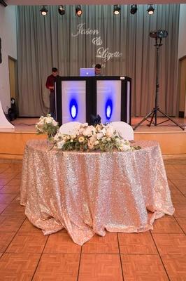 sweetheart table pink sequin table linen low florals on dance floor california wedding