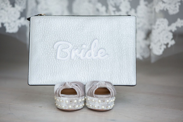 Wedding clutch on top of silver shoes silver leather clutch pouch with bride embroidery detailing