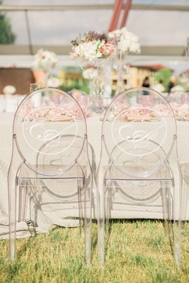 ghost chairs with monogram at wedding head table