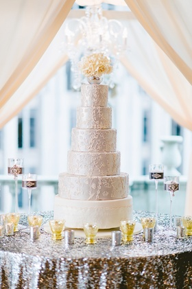 Six layer wedding cake with white bottom and silver top tiers