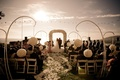 White rose ceremony decorations for sunset oceanview wedding