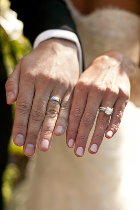 bride and groom show their wedding rings bands diamonds nails manicure