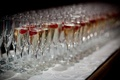 Hundreds of champagne glasses filled with bubbly and berries