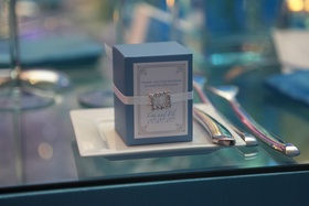 small blue and white box of wedding favors