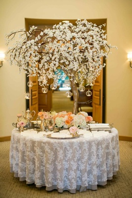 Treelike structure with hanging votives and silver
