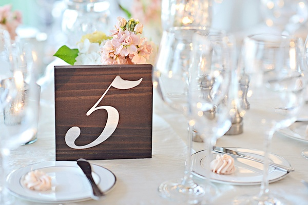 Number 5 five on wooden block table number