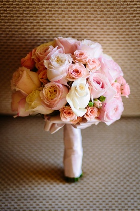 bridesmaid bouquet with pink roses, white roses, stem wrapped with blush ribbon