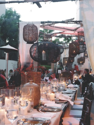 Bohemian-style lanterns hanging above tables