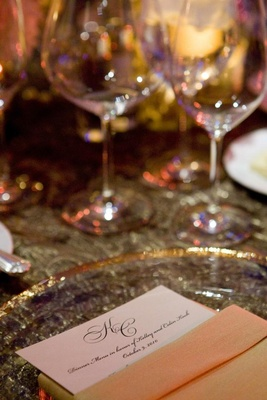 wedding reception place setting with a menu tucked into a napkin