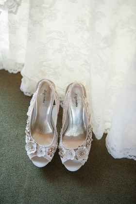 Wedding shoes with flower appliques and lace straps