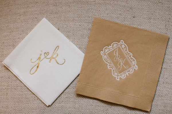 Fun modern calligraphy gold and white cocktail napkin and sophisticated monogram on tan napkin