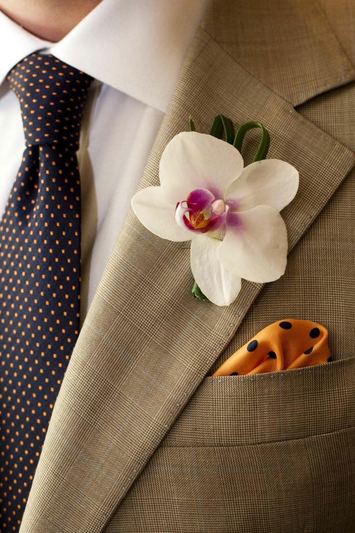 White orchid and polka dot pocket square