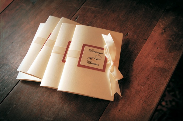 Ceremony booklets fastened with ribbon
