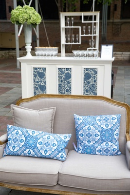 blue and white wedding décor, green bouquets, beige seating armchair bar