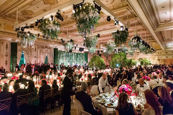 wedding reception ballroom greenery ceiling floral chandelier low centerpiece tall tree centerpieces