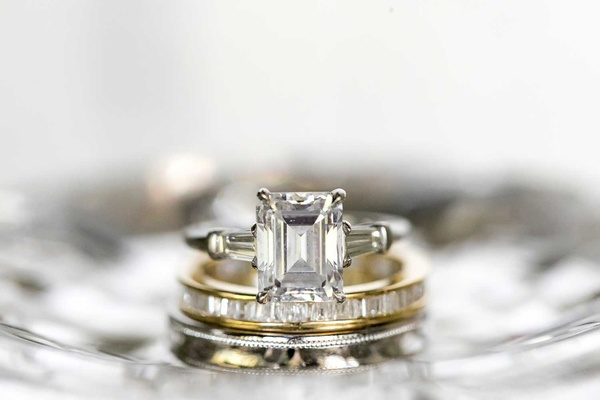 emerald cut diamond engagement ring with tapered baguette diamond side stones gold eternity band