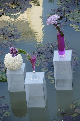 Clear Lucite risers with purple calla lily flower arrangements