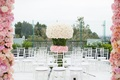 White ceremony seating on rooftop white flower pink rose arrangement in between seats