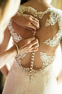 buttoning up back bridal gown lace buttons illusion getting ready wedding