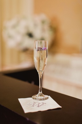 wedding drink champagne flute signature cocktail honeymoon destination champagne vodka and lavender