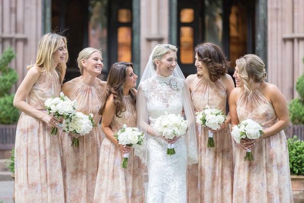 bridesmaids in high neck flower printed bridesmaid dresses hair in updo worn down