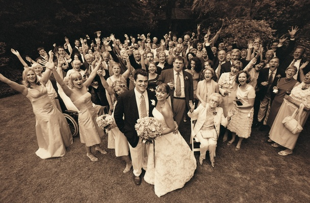 Sepia tone picture of bridal party and wedding guests