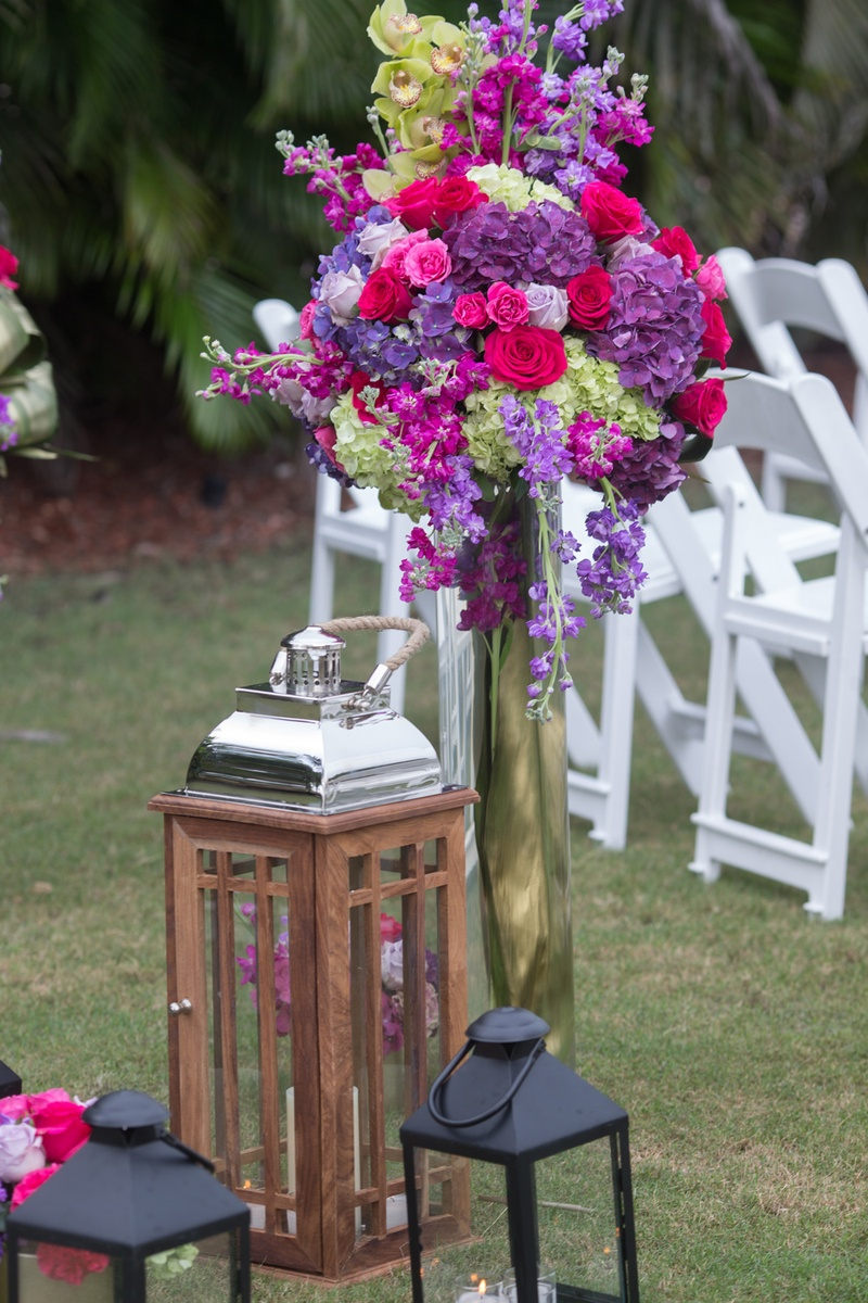 black lanterns, wooden and chrome lantern, purple, pink, fuchsia, green flowers