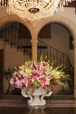 Wedding reception with a porcelain urn full green and pink flowers
