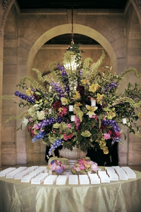 Large floral arrangement and simple seating cards