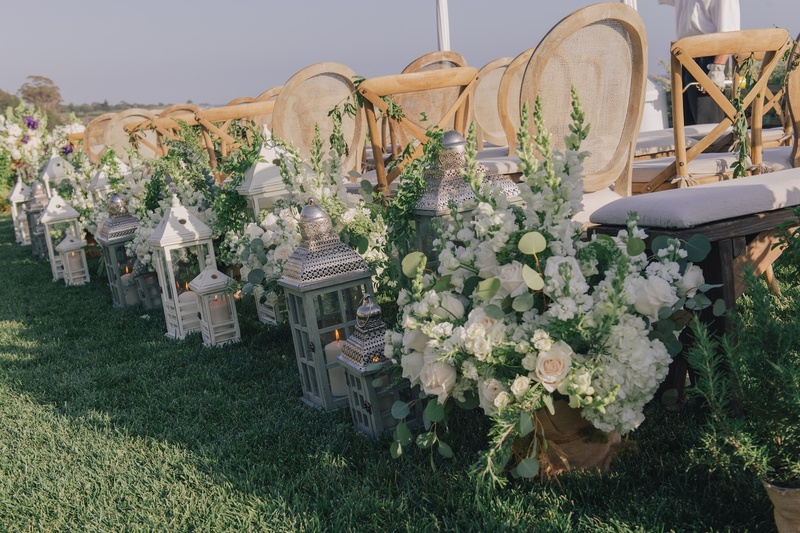 White floral arrangements and antique lanterns