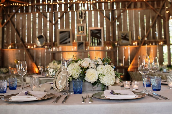 Barn wedding venue with rustic and vintage table decorations
