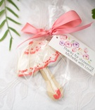Outdoor wedding shower with frosted parasol cookie favors, flowery label of thanks, pink ribbon bow