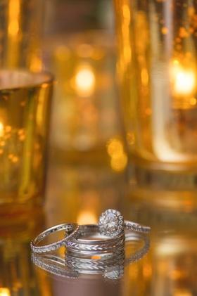 Bride's round diamond engagement ring, halo, band, diamond wedding band, groom's etched wedding band