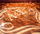 Monogrammed dance floor with projection lighting