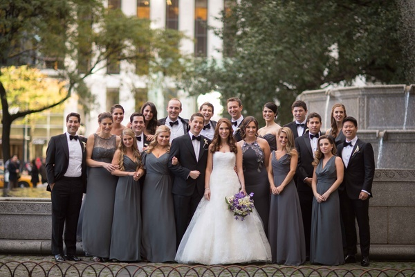 Bridesmaids in mismatched grey floor length long bridesmaid dresses groomsmen in tuxedos bride Vera
